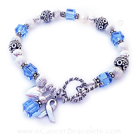 Prostrate Bracelet with Blue Crystals, a Ribbon charm and a Puffed Heart Charm - CBB-R25