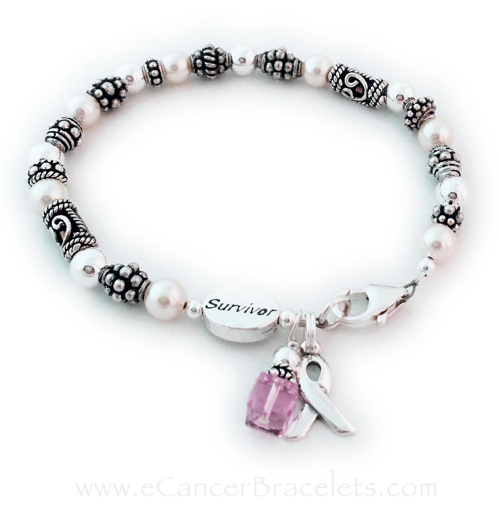 Shown with an Pink Swarovski crystal & Ribbon Charm & a lobster claw clasp.  *They added a SURVIVOR bead.*