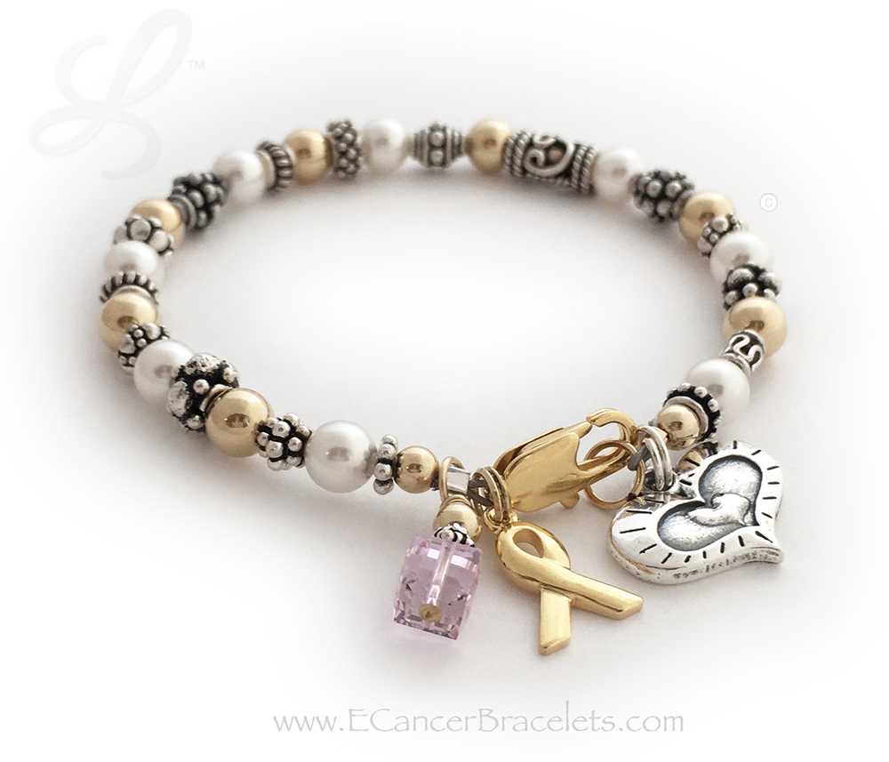 CBB-Ribbon 42Gold This bracelet comes with the any color crystal dangle (Light Purple shown) and Gold Ribbon Charm. This bracelet is shown with a 14k gold-plated Lobster Claw clasp. They added a Heart within a Heart Charm.