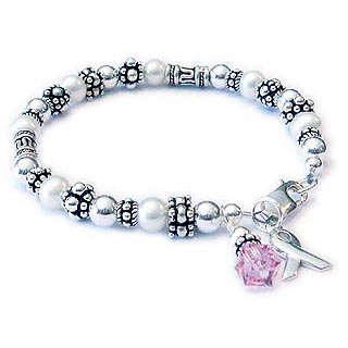 Survivor bracelet with Bali beads, a ribbon charm and pink crystal dangle charm. CBB-R42S