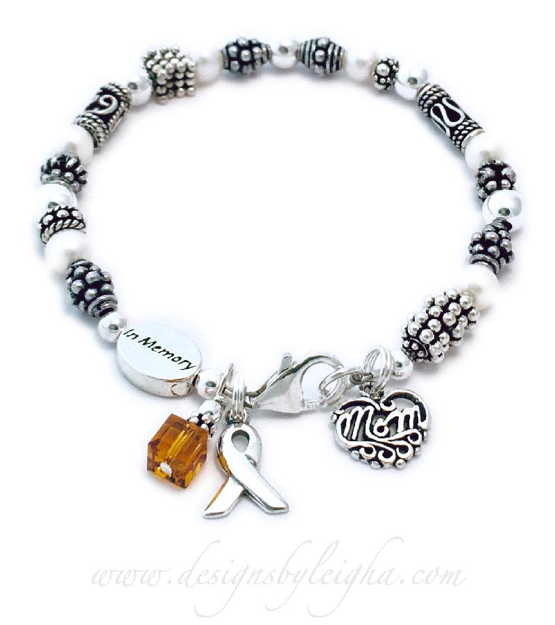 This is a leukemia orange ribbon bracelet shown with an Orange Swarovski crystal & Ribbon Charm with one of my free lobster claw clasps. They added an In Memory bead and a Filigree MOM charm.