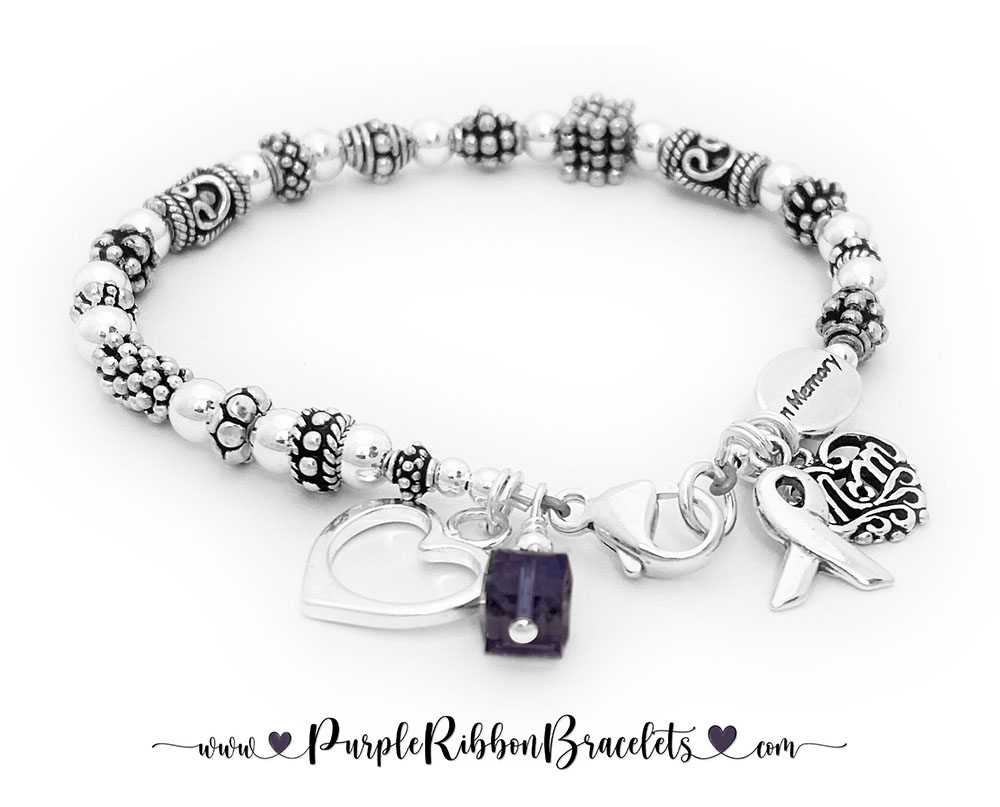 Purple Ribbon Bracelet  CBB-R42-Sterling This is a Purple Ribbon Bracelet shown with a Square Purple Swarovski crystal & Ribbon Charm with one of my free lobster claw clasps. They added an In Memory bead, a Filigree MOM charm and an Open Heart Charm.