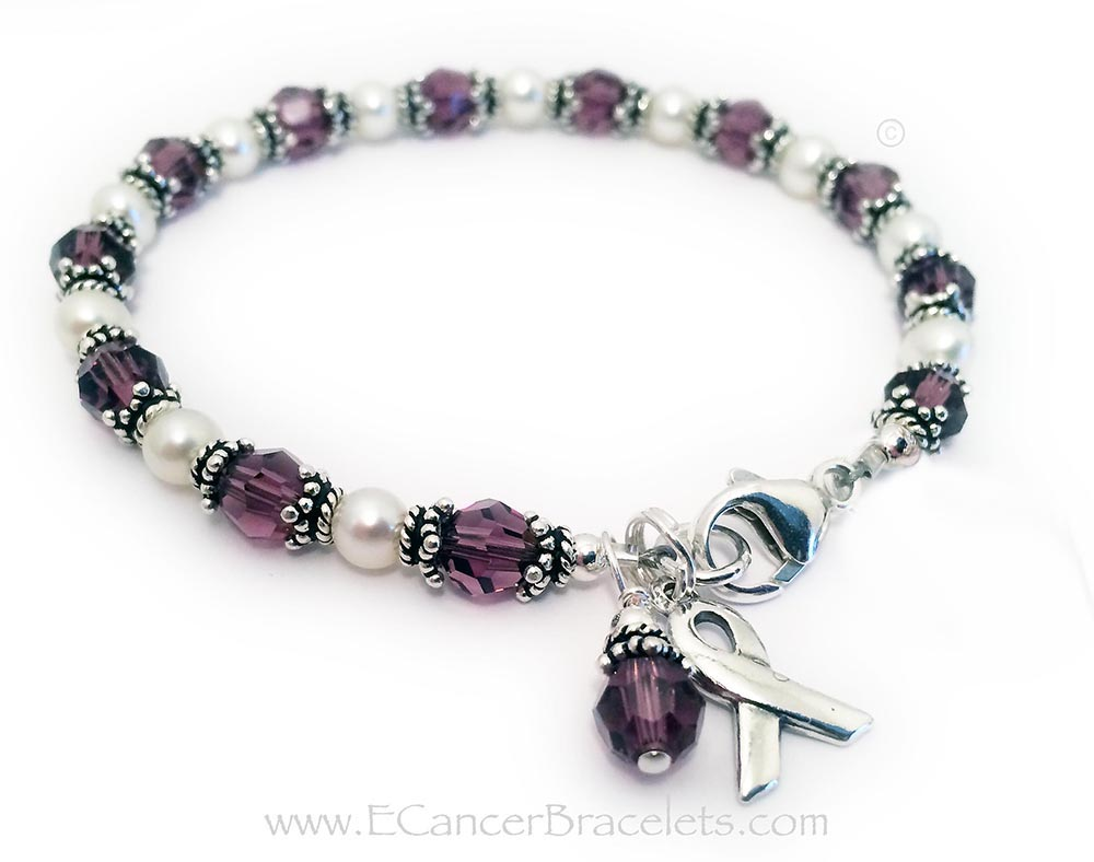 This is a Purple Ribbon Bracelet. It comes with a free clasp (lobster or toggle) , a Ribbon Charm and a Crystal Dangle Charm. They added an additional charm: Puffed Heart Charm.