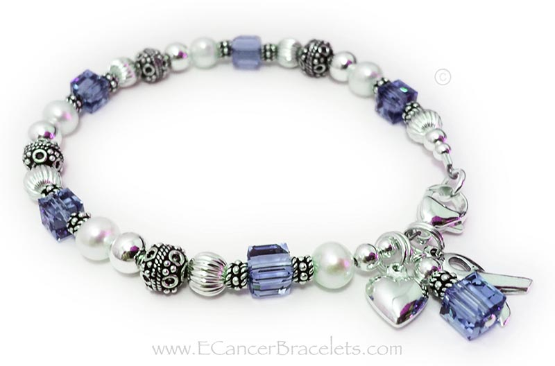 Alzheimer's Disease Awareness Bracelet This bracelet is shown with purple crystals signifying Alzheimer's Disease. It is also shown with a lobster claw clasp. It comes with the Ribbon Charm and Crystal Dangle. The puffed heart charm shown is an optional add-on.