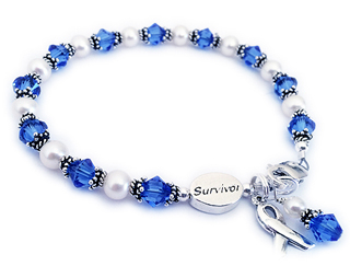 Colon Cancer Survivor Bracelet witha a Survivor Bead, blue crystals and a ribbon charm.