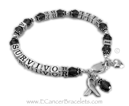 I will be a Melanoma Survivor Bracelet is shown with black Swarovski crystals and a sterling silver lobster claw clasp. They added 3 charms to their order: Ribbon Charm, Crystal Dangle and a Small Puffed Heart Charm.