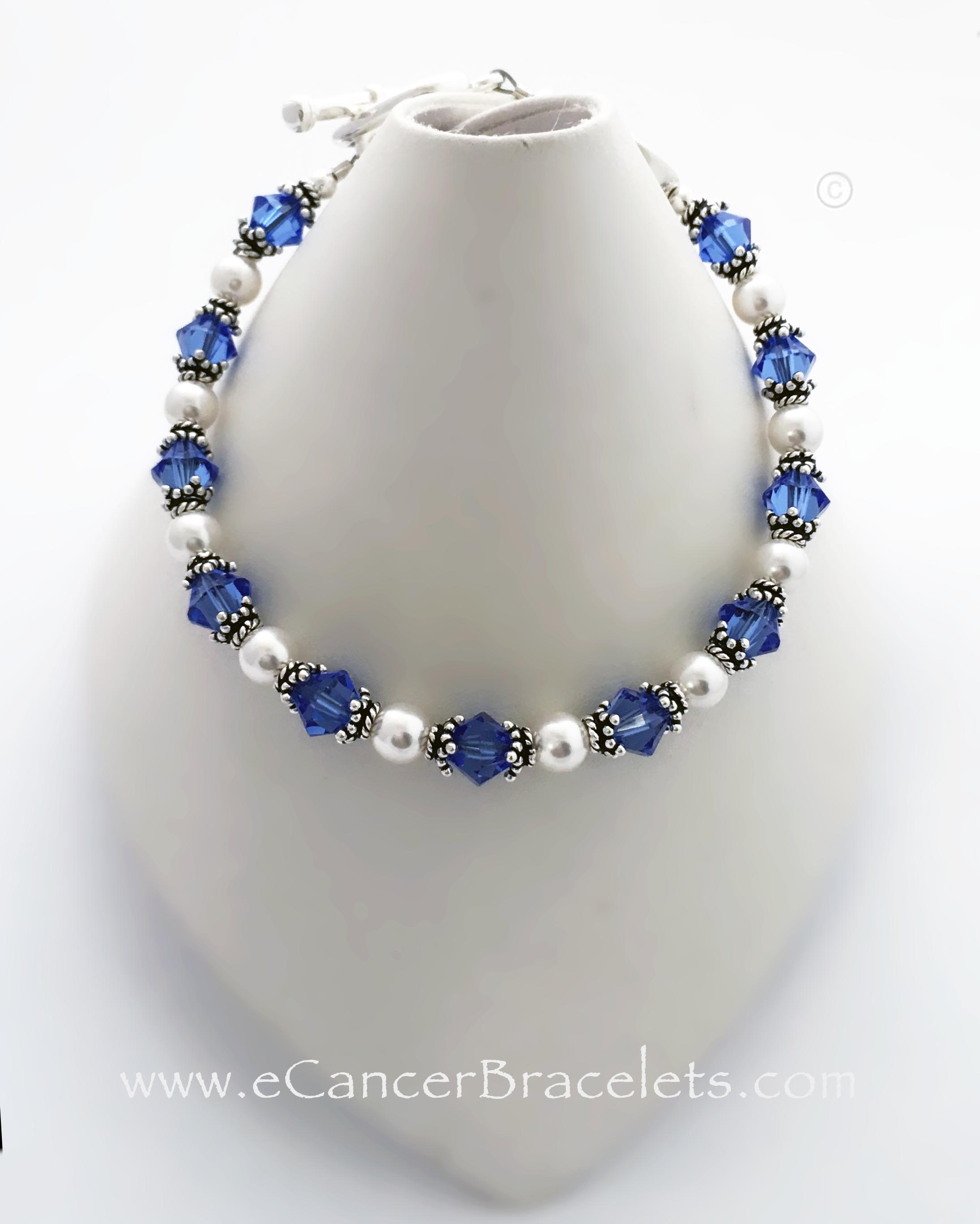 Blue Ribbon Bracelet with Courage Bead This bracelet is shown with blue crystals for colon cancer. It comes with a blue colon cancer charm and a ribbon charm. They added a COURAGE bead and upgaded to the Heart toggle clasp.