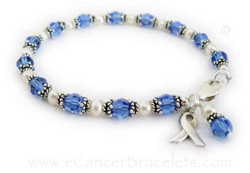Colon Cancer Bracelet with Blue Crystals and a Ribbon Charm. Shown with a lobster claw clasp.