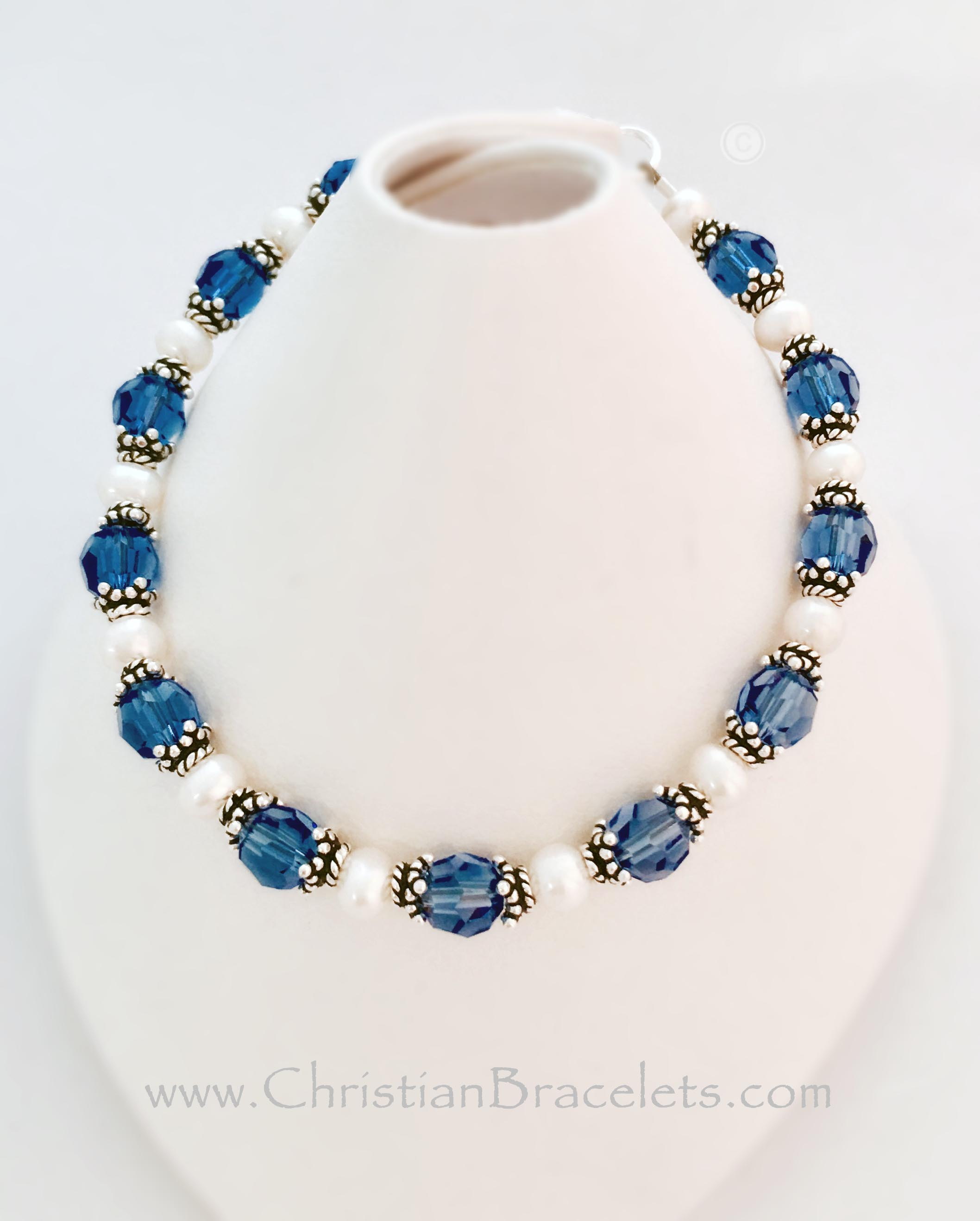 This Blue Ribbon Bracelet is shown with dark blue crystals which can signify Colon Cancer. A Ribbon and Crystal dangle charm are included in the price.