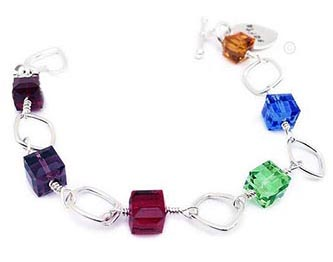 This Swarovski crystal Monogram Cancer Awareness Bracelet has large 8mm cube or square Swarovski crystals and open sterling silver 10-12mm square beads. You can have up to 6 different colors. The Monogram or Name Stamped Charm is included in the price. The sample is shown with an upgraded Heart Toggle clasp and a Baby Girl Bootie charm.