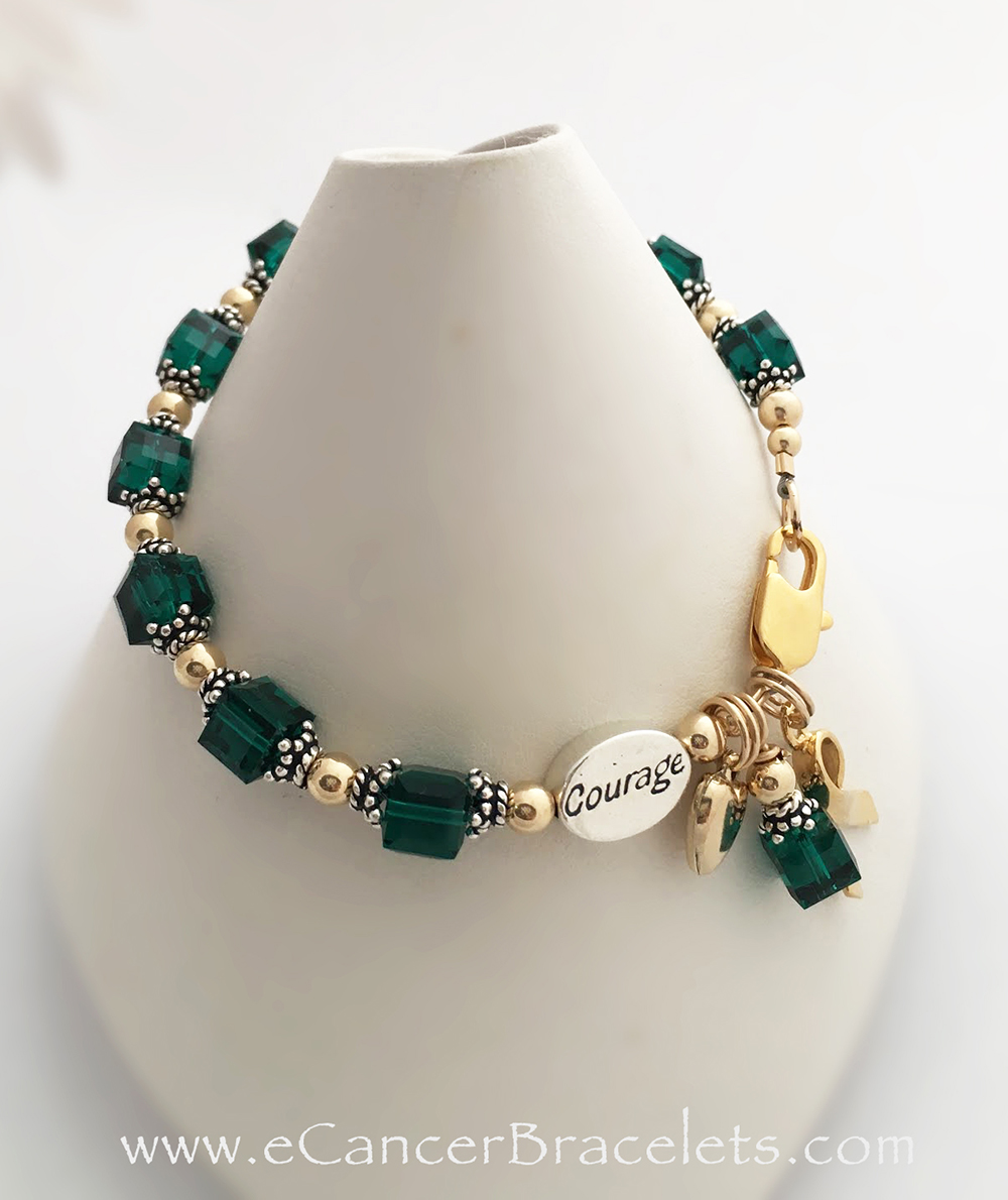 This Cancer COURAGE Bracelet comes with 2 charms; ribbon and dangle.  The Gold Heart charm is optional and they added a COURAGE bead. You may add a COURAGE, SURVIVOR, IN MEMORY or HOPE  bead to your bracelet order. You also choose the cancer or awareness color (GREEN is shown).