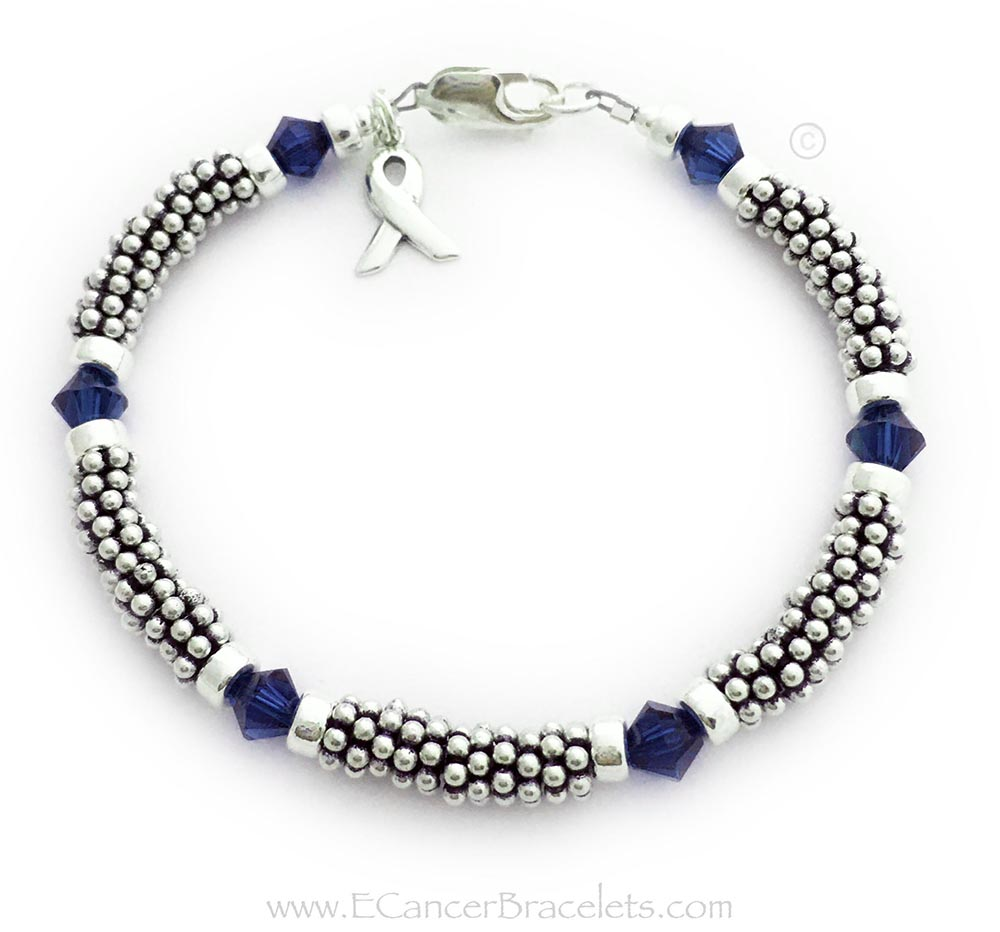 This is a 1-string Dark Blue Ribbon 6mm Rope Bracelet with a Ribbon Charm and a Lobster Claw Clasp. The Sterling Silver Rope Chain Beads and Dark Blue Swarovski Crystals are 6mm.