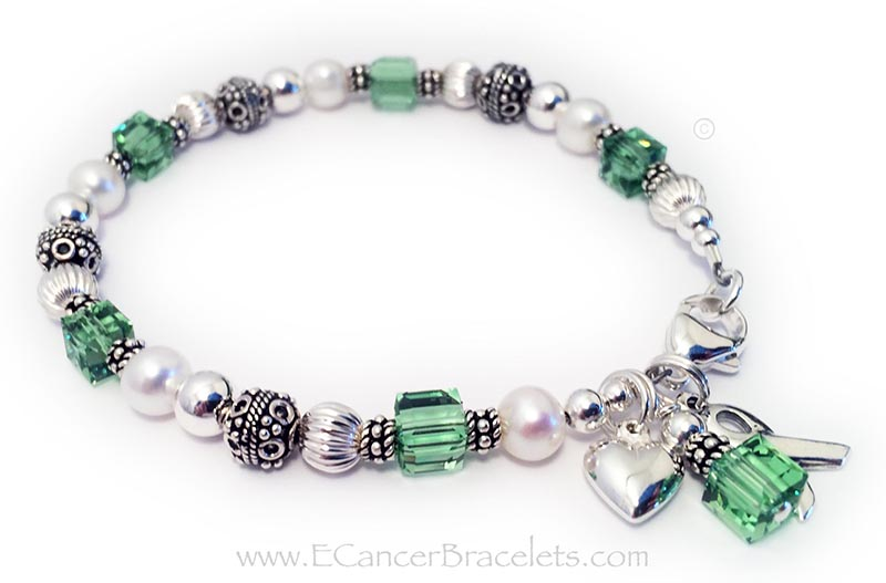 CBB-R25 Lymphoma Cancer Bracelet This bracelet is shown with light green crystals signifying Lymphoma. It is also shown with a lobster claw clasp. The puffed heart charm shown is an optional add-on.