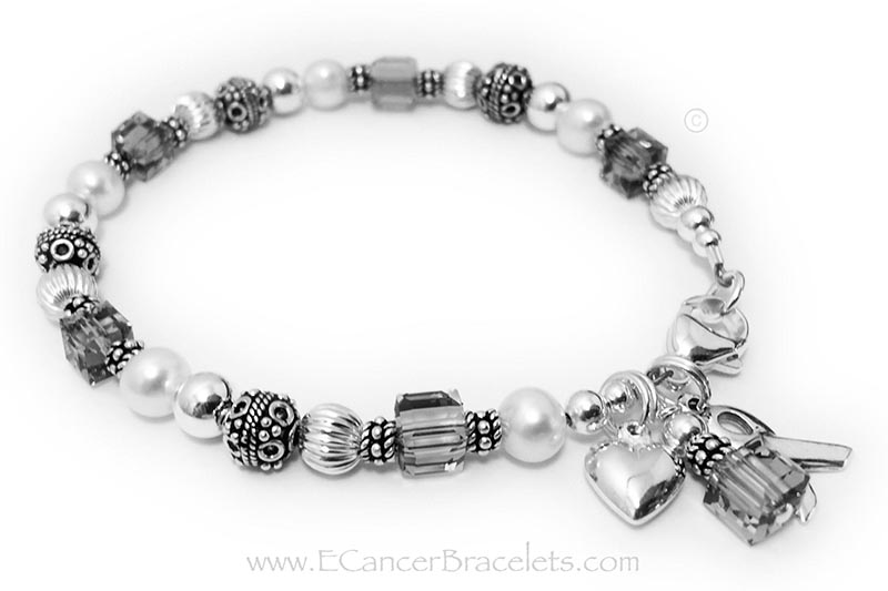 CBB-R25 Brain Cancer Awareness Bracelet This bracelet is shown with grey crystals signifying Brain Cancer Awareness. It is also shown with a lobster claw clasp. It comes with the Ribbon Charm and Crystal Dangle. The puffed heart charm shown is an optional add-on.