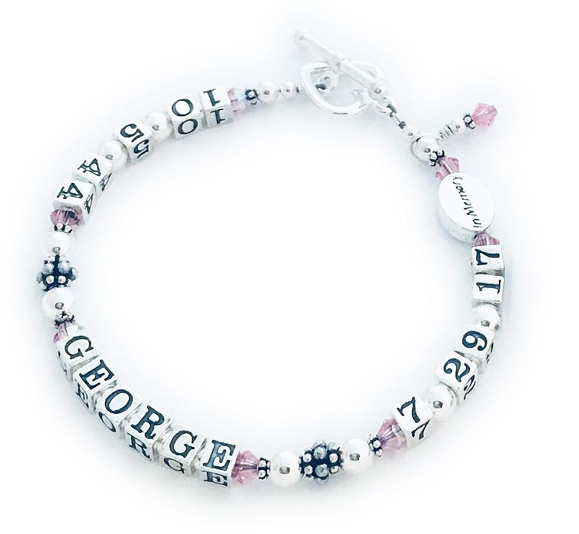 CBB-LIFETIME/sterling This life time bracelet is shown with October crystals and GEORGE. Changes: They upgraded to a Heart Toggle clasp and took off the ribbon charm.