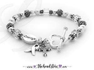 CBB-Ribbon25 - Lung Cancer Courage Bracelet Clear Crystals are for Lung Cancer. This is a Lung Cancer Courage Ribbon Bracelet and it includes a Ribbon Charm. They picked a COURAGE bead and added a Fancy Cross Charm. A free sterling silver lobster or toggle are includedin the price. They upgraded to think Heart Toggle Clasp.
