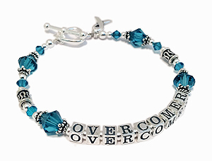 Teal Ribbon Bracelet with inspirational messages... OVERCOMER shown with a Heart Toggle Clasp. 18 Crystal Color Options - CBB-R27