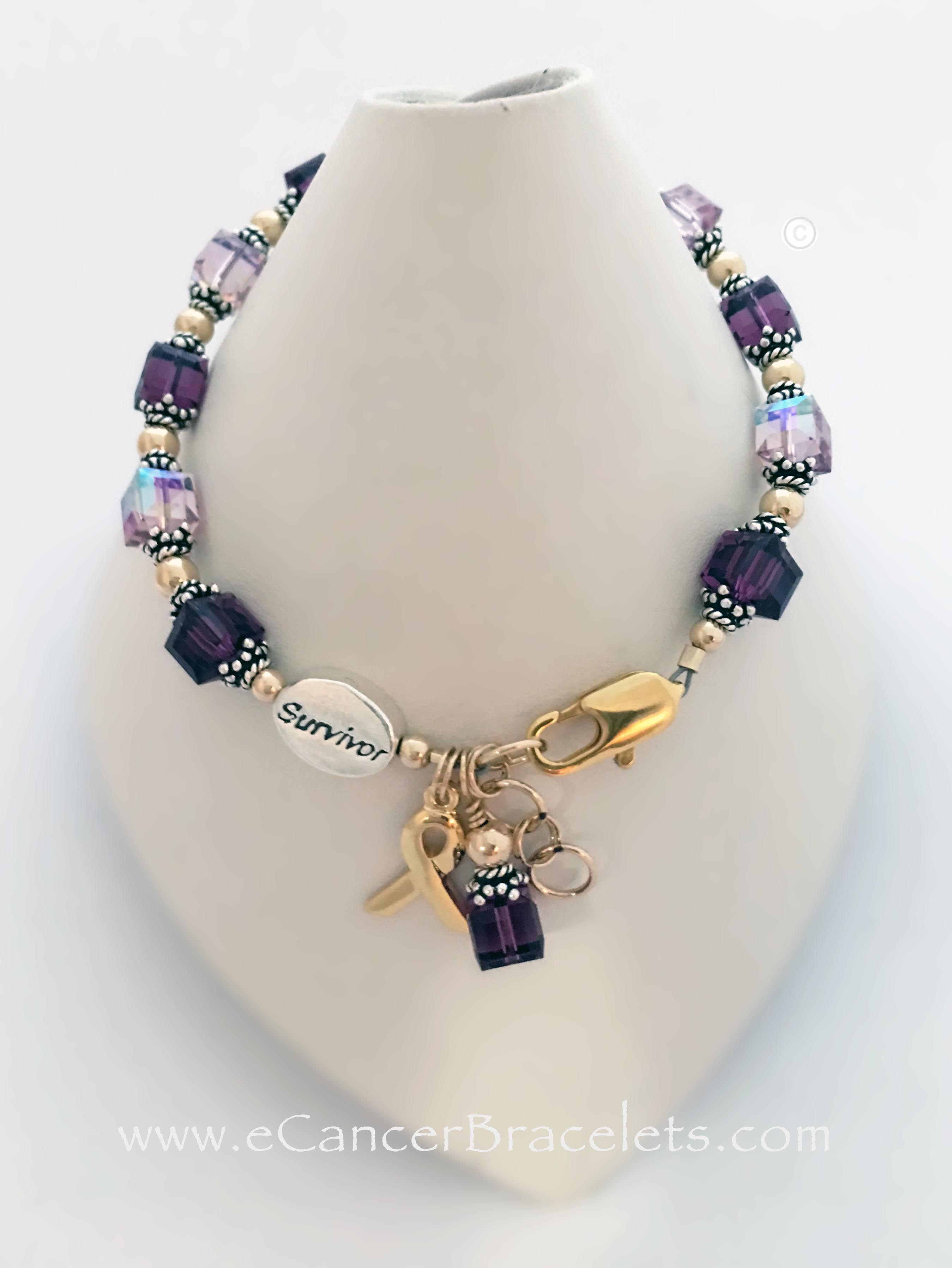 Lavender and Violet Ribbon Bracelet This bracelet comes with 2 charms; ribbon and dangle. They added a SURVIVOR bead, Coordinating Earrings and a Gold Lobster Extension Claps.
