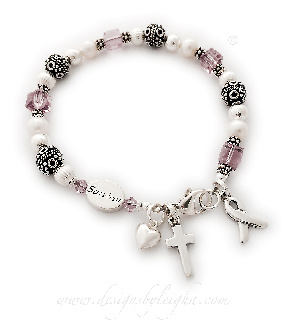 CBB-Ribbon25 - Violet Ribbon Bracelet (shown with add-on Survivor bead) This Violet ribbon bracelet includes Ribbon and colored dangle charm. They added a Survivor bead, a Small Puffed Heart Charm and a Simple Cross Charm.
